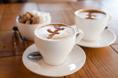 Cups of coffee and sugar — Stock Photo