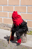 Executioner sitting near the wall on the street — Foto Stock