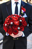 Groom holding the Bouquet — Stock Photo