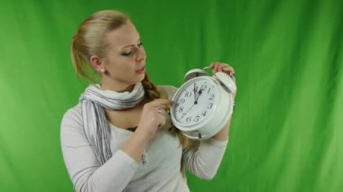 Young strict girl with a alarm clock in his hands. — Stock Video