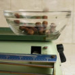 Old scales with mixed nuts and almonds. Slow motions picture. — Stock Video #38629743