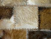 Stitched animal skins, decorative background — Stock Photo