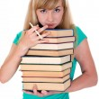 Weary girl holds lot of books — Stok fotoğraf