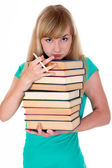 Weary girl holds lot of books — Stockfoto