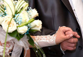Bride and groom hand in hand — Stock Photo