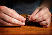 Pair of hands with wedding rings — Stock Photo