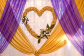 Wedding decor of the satin tapes and flowers — Stock Photo