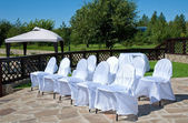Decorated chairs for the wedding ceremony — Stock Photo