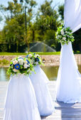 Decor for the wedding of white flowers — Photo