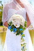 Brides bouquet in hands — Stock Photo