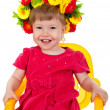 Beautiful enjoy a nice little girl is sitting on a chair — Stock Photo