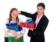 Young man giving a gift the girl — Stock Photo
