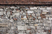 Old rugged stone wall — Stock Photo