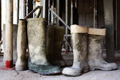 Dirty galoshes at a construction site — Stock Photo