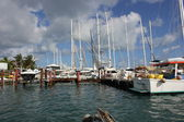 Boats and Yachts sit idle along one of Simpson Bay's Dock Slip in St. Martin — Foto Stock