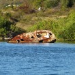 Neglected rusting ship needing salvage at Simpson Bay in St. Maarten — Stock Photo #40812635