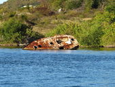 Neglected rusting ship needing salvage at Simpson Bay in St. Maarten — Stock Photo