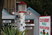 Tourist Guidepost as to World Cities and Distances from Guava Berry Rum Store in Philipsburg St. Maarten — Stock Photo