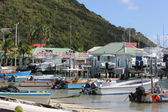 Motor Boats and Yachts in distance near water taxi area of Great Beach in Philipsburg St. Maarten — Stock Photo
