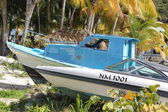 Colorful boat sits idle at boat slip on Great Beach in Philipsburg St. Maarten — Stock Photo