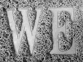 Popular metal texture pattern text we — Stock Photo
