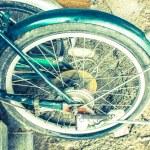 Bike wheel plate dish metallic parts in garage — Stock Photo #40889423