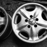 Wheel plate dish metallic auto car parts in garage — Stock Photo #40889519