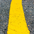 Stock Photo: Asphalt road yellow line close up background