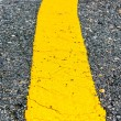 Asphalt road yellow line close up background — Stock Photo #40893179