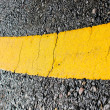 Asphalt road yellow line close up background — Stock Photo #40893255