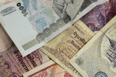 A collection of various currencies from countries the globe — Stock Photo