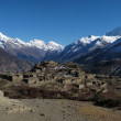 Ruins of a beautiful old village near Manang and high mountains — ストック写真
