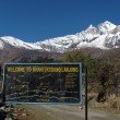 Stock Photo: Dhaulagiri and signboard with trekking routes