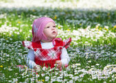 Little baby on green grass — Stock Photo