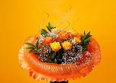 Bunch of flowers on orange background — Stock Photo