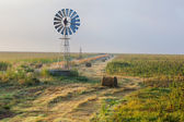 Windmill along the line — Stock Photo
