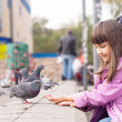 Small caucasigirl feeding pigeons — Photo #35035695