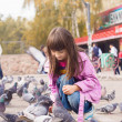 Small caucasigirl feeding pigeons — Photo #35036473