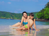 Mother and her little daughter on the beach — Stock Photo