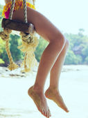 Legs of young girl on the beach — Stock Photo