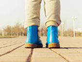 Boots of child walking at park — Stock Photo