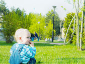 Baby in the park — Stock Photo