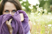 Portrait of a beautiful woman with blue eyes and a purple scarf — Stockfoto