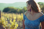 Beautiful woman looking at vineyard — Stock Photo