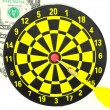 Dartboard game and dollar on white background — Stock Photo