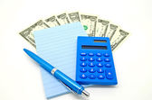 Some money with blue notepad and calculator — Stock fotografie