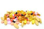 Pile of different types of pills and tablets — Stock Photo