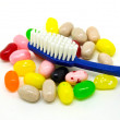 Foto de Stock  : Toothbrush and candies