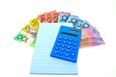 Some Australian money with blue notepad and calculator — Stockfoto