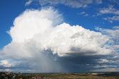 The big storm cloud above city — Stock Photo